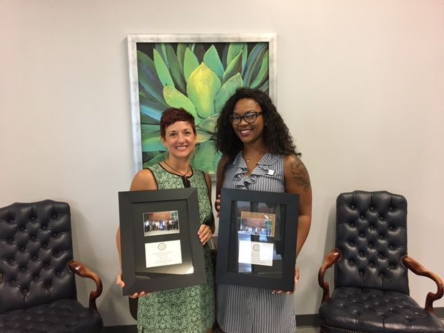 AccessHealth Spartanburg employees holding awards the organization has won.